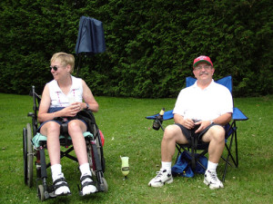 jc1230 montpelier vt vermont handicapped woman couple sitting fourth july picnic